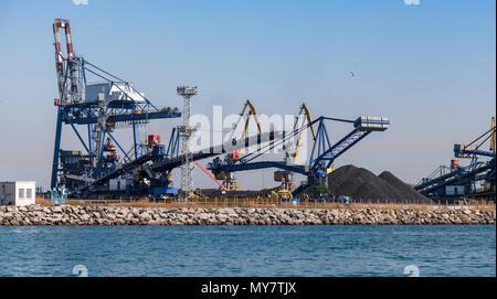 Gantry and bulk cranes are in Port of Burgas, Black Sea, Bulgaria - Stock Photo