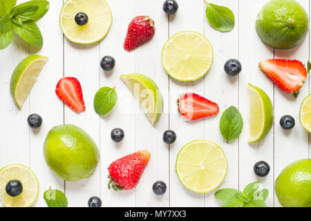 Fresh berries of citrus lime mint blueberries strawberry on a light background. Flat lay summer. - Stock Photo