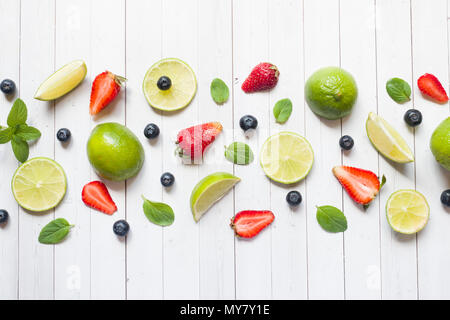 Fresh berries of citrus lime mint blueberries strawberry on a light background. Copy space for text. - Stock Photo