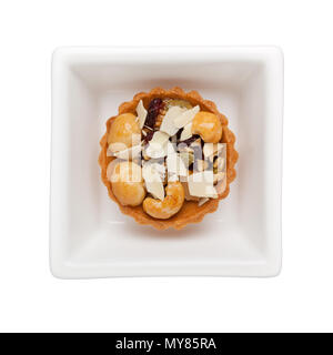 Mixed nuts tart in a square bowl isolated on white background - Stock Photo