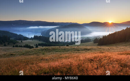 Meadow and hills at sunrise, Mlynky, Slovakia - Stock Photo