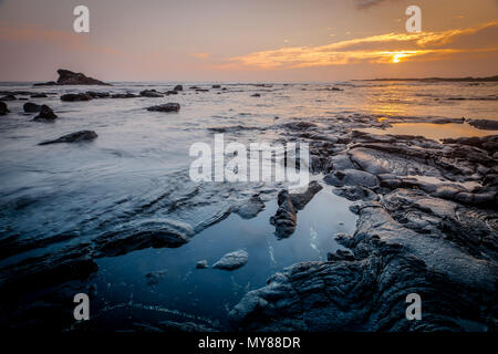 Lava Stone in the Pacific Ocean at Sunset - Stock Photo