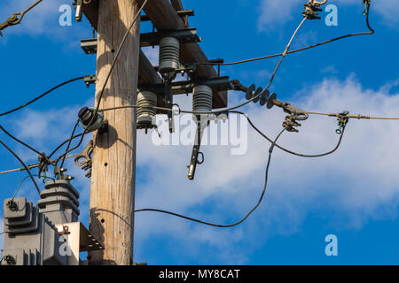 some electrical equipment high up on a pole four - Stock Photo