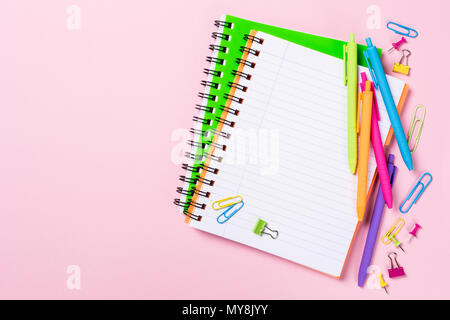 School background with notebooks and colorful supplies - Stock Photo
