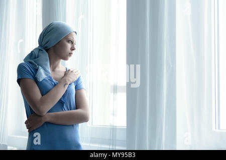 Woman with cancer  disease alone in hospital - Stock Photo