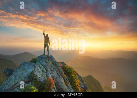 Mountain valley during bright sunset. Beautiful natural landscape in the summer time - Stock Photo