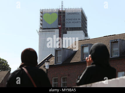 Banners are unveiled on the outside of Grenfell Tower in west London. - Stock Photo
