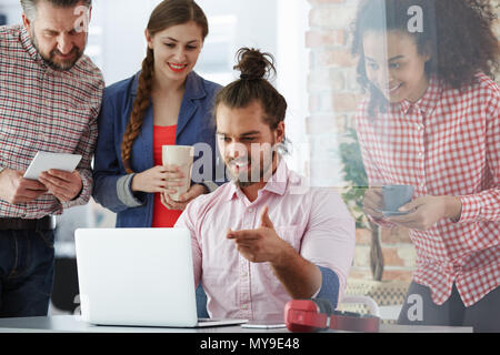 Workers of advertising agency working on new campaign - Stock Photo