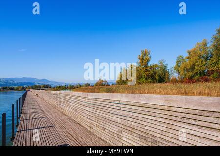 Wooden bridge over Lake Zurich between the town of Rapperswil and the village of Hurden - the longest wooden bridge in Switzerland. - Stock Photo