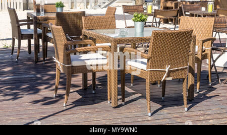 Unoccupied outdoor furniture in the outdoor area of a restaurant is waiting for the customers who eat, drink and smoke here, germany - Stock Photo
