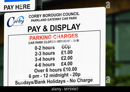 Car park pay and display parking charges notice outside the Cube in the town of Corby, Northamptonshire, England. - Stock Photo