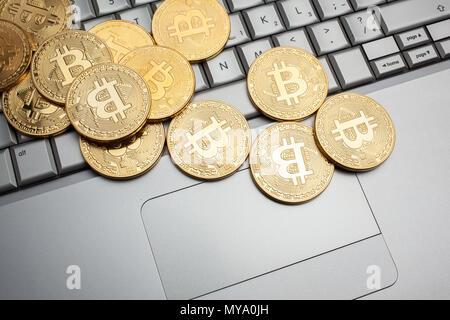 bitcoins on keyboard - Stock Photo