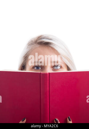 Close up portrait of pretty student girl hiding behind a red opened book isolated on white background. Mysterious and shy woman keeping a secret. Educ - Stock Photo