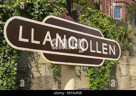 Llangollen platform sign at the preserved heritage steam railway in North Wales - Stock Photo