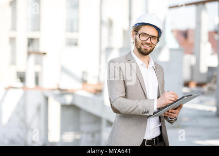 Engineer with tablet on the structure - Stock Photo