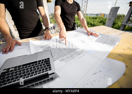 Working at the construction site outdoors - Stock Photo