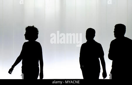 Silhouettes of young people walking in the night - Stock Photo