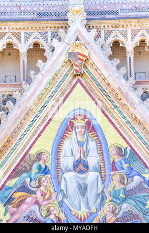 Detail of the facade of the cathedral of Orvieto, Umbria, Italy. Mosaic depicting the assumption of the Virgin Mary - Stock Photo