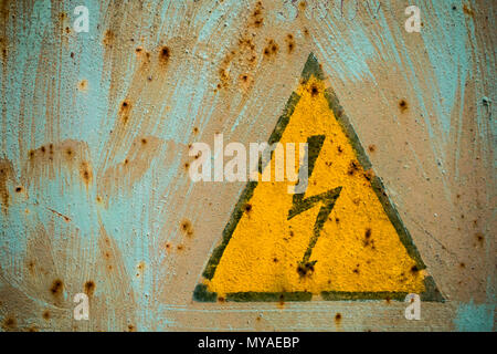 sign electrical hazard placed on a rusty metal panel. - Stock Photo