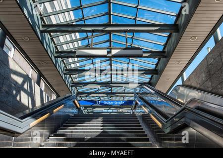 Berlin Osloerstrasse U-bahn railway station serves U8 & u9 lines. Glass covered entrance,stairs & escalators. - Stock Photo