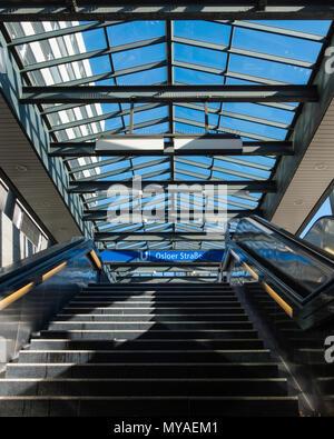Berlin Osloerstrasse U-bahn railway station serves U8 & u9 lines.Glass covered entrance,stairs & escalator.Named after city of Oslo - Stock Photo