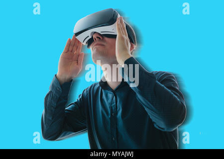 The man in the glasses of virtual reality. The concept of modern technologies and technologies of the future. VR glasses - Stock Photo