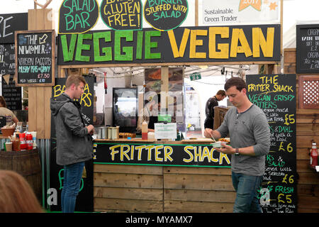 Veggie food stall and Fritter Shack sign in the Hay Festival Food Hall Hay-on-Wye Wales UK  KATHY DEWITT - Stock Photo