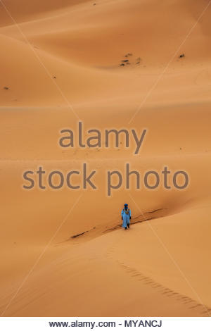 Walking the Dunes Sahara Desert Morocco - Stock Photo