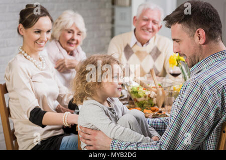 Happy family during dinner celebrating father's day, smiling - Stock Photo