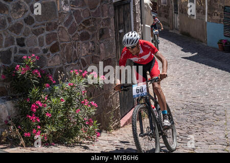 Turkish cyclist competes in an international mountain bike race in the Greek village of Molyvos on the island of Lesvos - Stock Photo