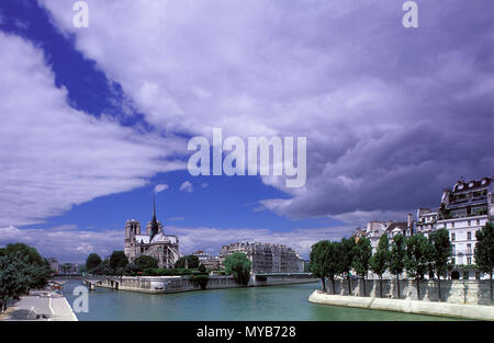 Notre Dame on Ile de la CitŽ, as seen over the Seine looking west with dramatic clouds after the storm had passed, Paris, France - Stock Photo