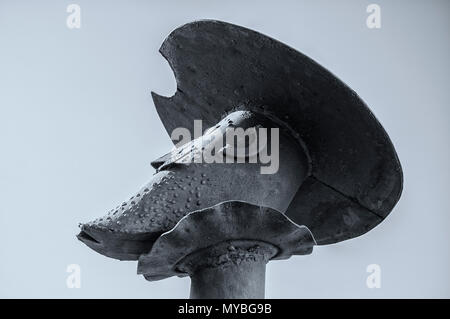 Head of Don Quixote with Mambrino Helmet. Steel sculpture. Saceruela, Ciudad Real, Spain - Stock Photo