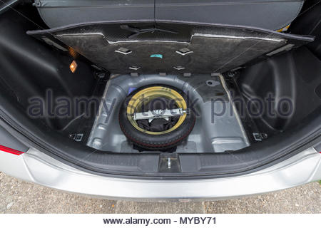 Space saver spare wheel in the boot of a Honda Jazz car - Stock Photo