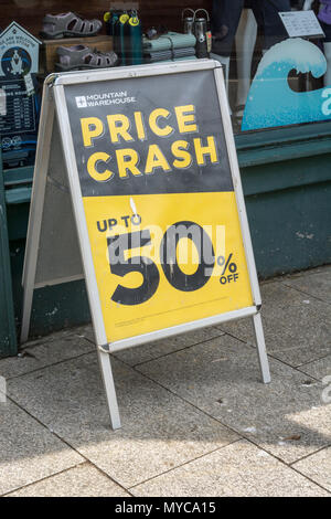 Price reduction shop poster - metaphor for struggling retailers and death of the high street, high street squeeze. - Stock Photo