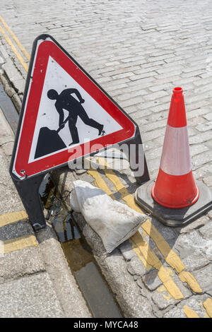 Man at Work roadworks sign in Truro, Cornwall. Concept roadworks, road maintenance, road works UK. Men at work pictogram. - Stock Photo