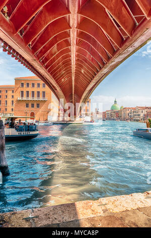 VENICE, ITALY - APRIL 29: Underneath the controversial Constitution Bridge in Venice, Italy on April 29, 2018. Designed by the starchitect Santiago Ca - Stock Photo