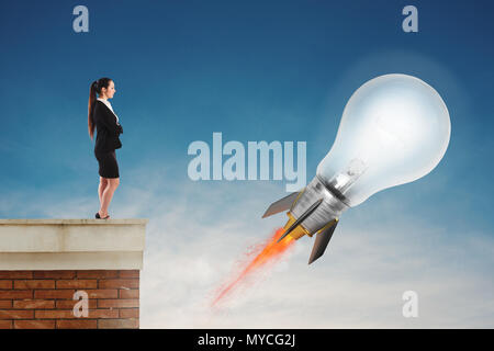 Fast lightbulb as a rocket ready to fly fast. Concept of new super idea - Stock Photo