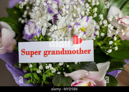 Grandparents Day. Greeting Card with Flowers and Text - You are my super grandmom. bouquet of different flowers and orchids for best grandma. Super grandmother card. - Stock Photo