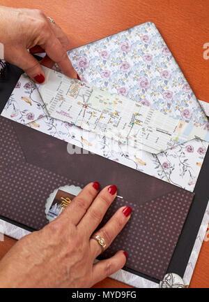Scapbook empty album with textured envelope - Stock Photo