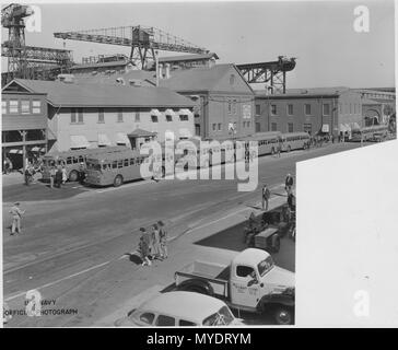 During WWII a fleet of 3,000 buses provided transportation the over 42,300 employees. One of the main bus stops was... - - Stock Photo