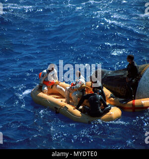 Gemini XI astronauts Richard F. Gordon Jr. (left), pilot, and Charles Pete Conrad Jr., command pilot, sit in a life raft while awaiting pickup by a helicopter from the USS Guam. 9 15 1966 - Stock Photo