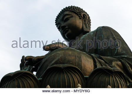 The Tian Tan Buddha, a large bronze statue of Buddha Shakyamuni, overlooks the Po Lin Monastery. - Stock Photo