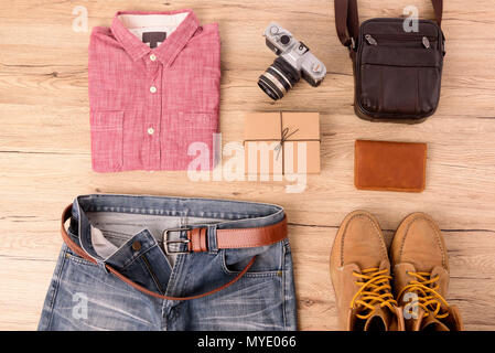 Top view Men's fashion on wooden table. - Stock Photo