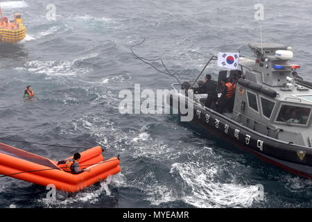 Busan, South Korea. 07th June, 2018. BUSAN, SOUTH KOREA - JUNE 7, 2018: Joint multitask military exercises take place off the South Korean port city of Busan, as part of the North Pacific Coast Guard Forum, and involve 13 patrol vessels, five helicopters and special task units of South Korean, Russian, Chinese, Japanese, American and Canadian servicemen. Stanislav Varivoda/TASS Credit: ITAR-TASS News Agency/Alamy Live News - Stock Photo