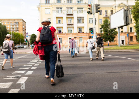 People cross the road on the pedestrian crossing - Stock Photo