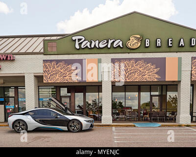 BMW i8 luxury electric hybrid plug-in super car parked in front of Panera Bread in Opelika Alabama, USA. - Stock Photo
