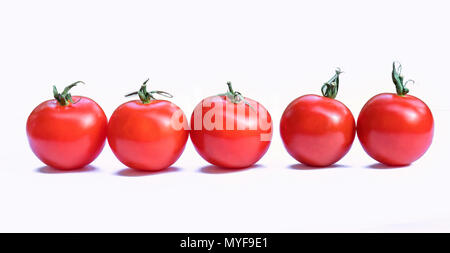 Red cherry tomatoes isolated on white background. This is a fruit rich in vitamin C and minerals that are beneficial to human health - Stock Photo
