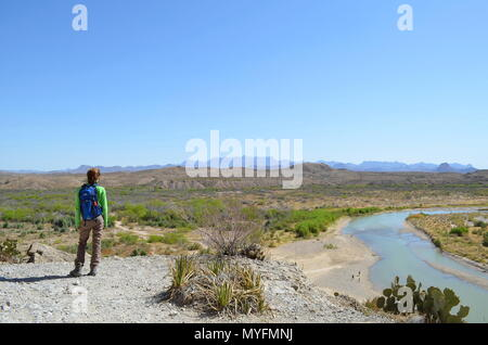 Girl hiking along the Rioi Grande in Big Bend State Park.
