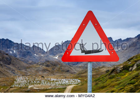 A dogsled road sign at the Inuit Village of Tasiilaq. - Stock Photo