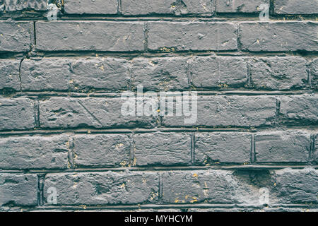 Old grey brick wall for background - Stock Photo